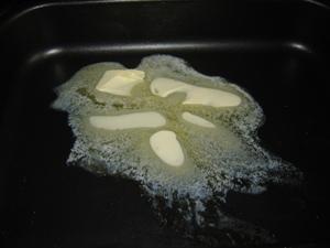 Patatas con setas, crema agria y queso al horno